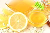 Sweet honey with lemon close up — Stock Photo
