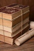 Old books on table on brown background — Zdjęcie stockowe