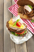 Delicious sandwiches with meet on table close-up — Stock Photo