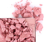 Crushed eyeshadow isolated on white — Stock Photo