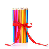 Colorful pencils vase with red ribbon isolated on white — Photo