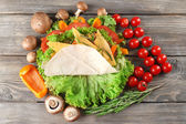 Veggie wrap filled with cheese and fresh vegetables on table — Stock Photo