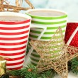 Cups of hot cacao with Christmas decorations on table on bright background — Stock Photo #47914529