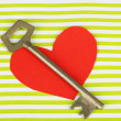 Key of happiness. Conceptual photo. Key with red paper heart, on green wooden background — Stock Photo