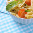 Delicious pasta with tomatoes on plate on table close-up — Stock Photo #47914853