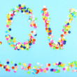 Word Love from confetti on blue background — Stock Photo #47915621