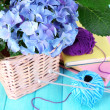Hydrangea with books and threads on table close-up — Stock Photo