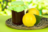Sweet quinces with jam on table on bright background — Stock fotografie
