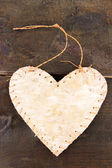 Decorative heart with rope, on grey wooden background — Stock Photo