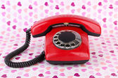 Red retro telephone on bright background — Stockfoto