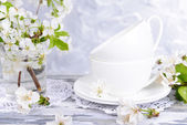 Beautiful fruit blossom in glass on table on grey background — Stock Photo