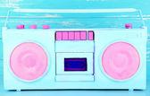 Colorful retro radio, on blue wooden background — Stok fotoğraf