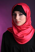 Beautiful muslim arabic woman on dark color background — Stock fotografie
