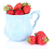 Ripe sweet strawberries in color mug isolated on white — Zdjęcie stockowe