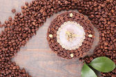 Beautiful clock of coffee beans, on wooden  background — Stock Photo
