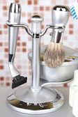 Male luxury shaving kit on shelf in bathroom — Stock Photo