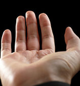 Human hand on black background — Stock Photo
