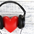 Headphones and heart on wooden background — Stock Photo #47922509