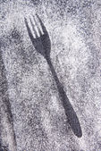 Imprint fork made of flour on table close-up  — Stock Photo