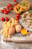 Still life with raw homemade pasta and ingredients for pasta — 图库照片