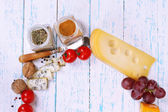 Different types of cheese with vegetables and spices  on table close-up — Stock Photo