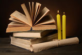 Old books on table on brown background — Photo