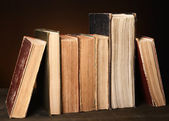 Old books on table on brown background  — Stock fotografie
