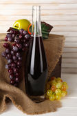 Beautiful still life with bottle of wine — Stock Photo