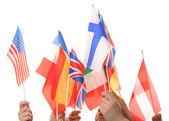 手里拿着不同的旗帜,白色衬底上分离 — 图库照片