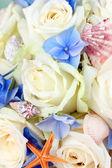 Beautiful wedding bouquet with sea decor, close up — Stock Photo