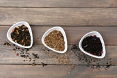 Assortment of dry tea on wooden table — Stock Photo