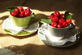 Sweet cherries on wooden table  — 图库照片