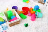 Colorful toys on fluffy carpet in children room — Zdjęcie stockowe