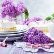 Delicious dessert with lilac flowers — Stok fotoğraf