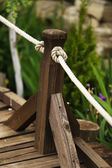 Old wooden fence in the garden — Stock Photo