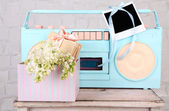 Still life with colorful retro radio, on grey wall wooden background — Stockfoto