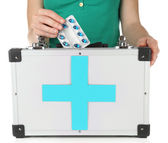 Woman holding first aid kit, isolated on white — ストック写真