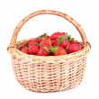Ripe sweet strawberries in wicker basket, isolated on white — Stock Photo #47960447