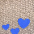 Blue hearts made of felt on golden background — Stock Photo #47963727