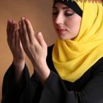 Beautiful muslim arabic woman praying on dark color background — Stock Photo #47965853
