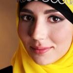 Beautiful muslim arabic woman on dark color background — Stock Photo #47966693