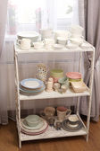 Different tableware on shelf in the interior — 图库照片