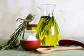 Essential Oil with rosemary in glass jug, on light background — 图库照片
