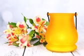 Bright icon-lamp with flowers on table on bright background — Stock Photo