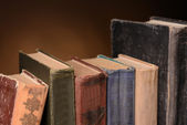 Old books on brown background — Stock Photo
