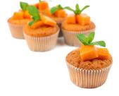 Tasty pumpkin muffins, isolated on white — Stockfoto