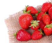 Ripe sweet strawberries on sackcloth napkin isolated on white — Stockfoto