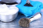 Male luxury shaving kit with towel on gray background — Stock Photo