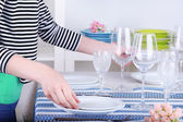 Woman laying table in room — Stock Photo