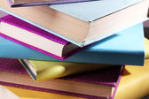 Stack of colourful hardback and paperback books, close-up — Stock Photo